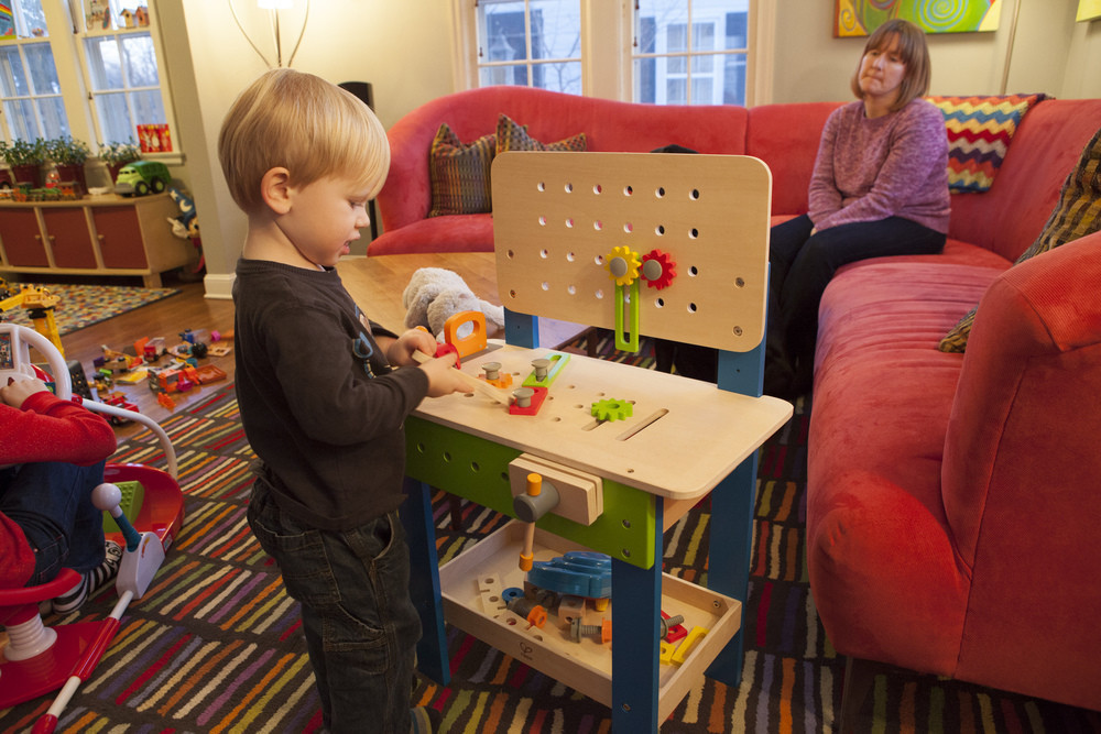 Tyler playing with his new worktable.